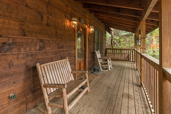 covered deck with a bench rocker and swing at amazing journey a 5 bedroom cabin rental located in pigeon forge