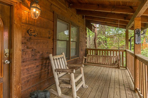 porch swing and rocker on a covered deck at amazing journey a 5 bedroom cabin rental located in pigeon forge