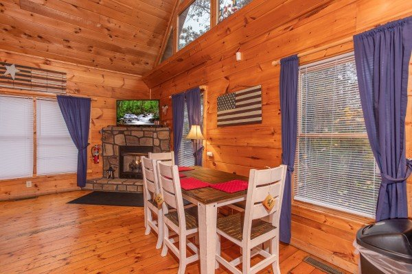 Dining space for four in the main room at Patriot Inn, a 1 bedroom Gatlinburg cabin rental