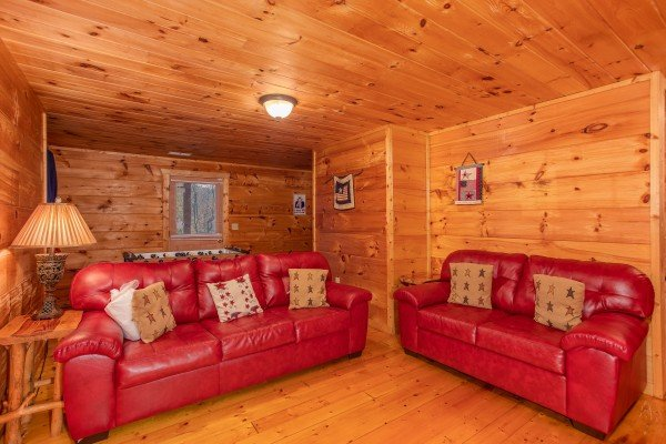 Two sofa beds in the first floor game room at Patriot Inn, a 1 bedroom Gatlinburg cabin rental