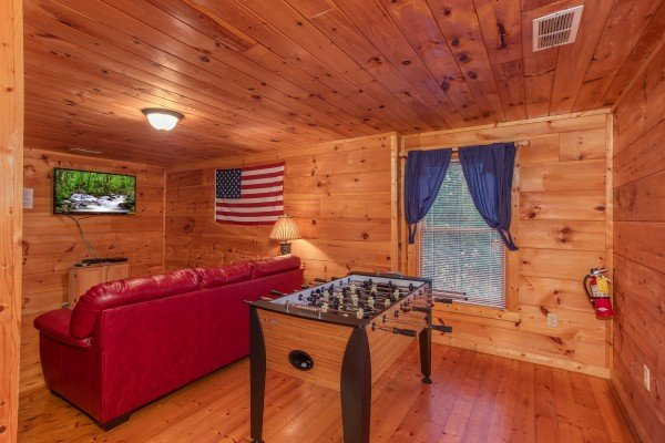 Foosball table in the first floor game room at Patriot Inn, a 1 bedroom Gatlinburg cabin rental