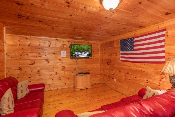 Sleeper sofas and TV in the first floor game room at Patriot Inn, a 1 bedroom Gatlinburg cabin rental