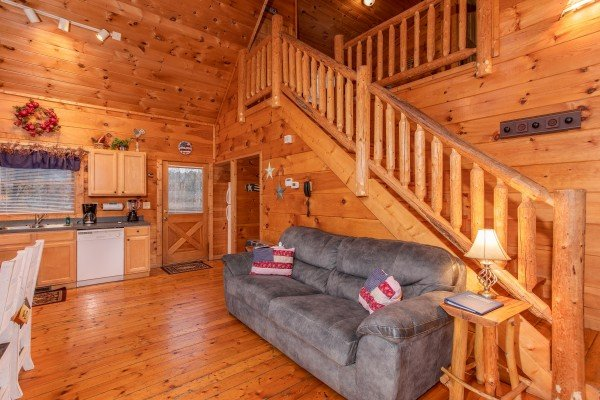 Sofa in the open concept great room at Patriot Inn, a 1 bedroom Gatlinburg cabin rental