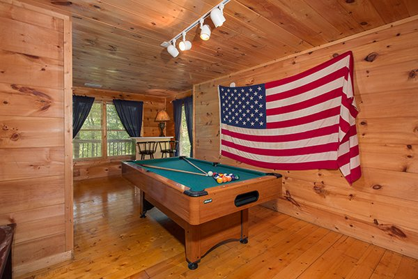 Pool table in the first floor game room at Patriot Inn, a 1 bedroom Gatlinburg cabin rental