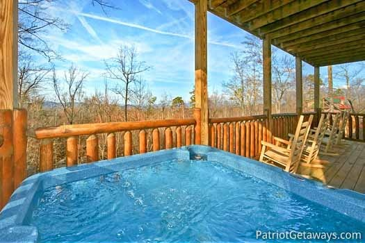 Back deck with hot tub at Tree Top Lodge, a 3 bedroom cabin rental located in Gatlinburg