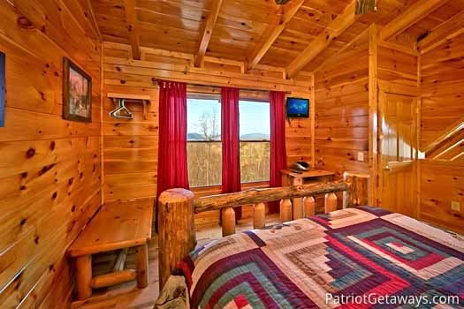 bedroom in loft with queen bed at tree top lodge a 3 bedroom cabin rental located in gatlinburg