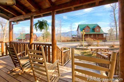 Front porch with rockers at Tree Top Lodge, a 3 bedroom cabin rental located in Gatlinburg