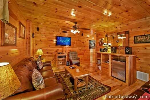 Game room TV area at Tree Top Lodge, a 3 bedroom cabin rental located in Gatlinburg