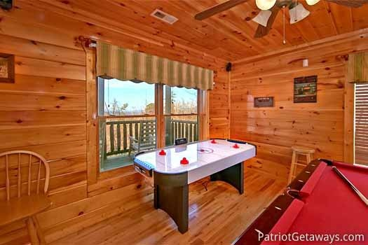 Game room with air hockey table at Tree Top Lodge, a 3 bedroom cabin rental located in Gatlinburg