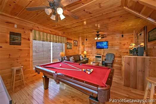 Game room with pool table at Tree Top Lodge, a 3 bedroom cabin rental located in Gatlinburg