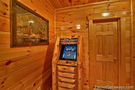 Game room with video arcade game at Tree Top Lodge, a 3 bedroom cabin rental located in Gatlinburg