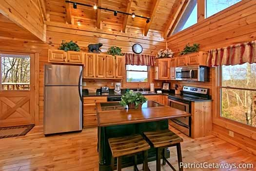 kitchen with stainless steel appliances at tree top lodge a 3 bedroom cabin rental located in gatlinburg
