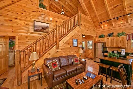 Living room staircase at Tree Top Lodge, a 3 bedroom cabin rental located in Gatlinburg