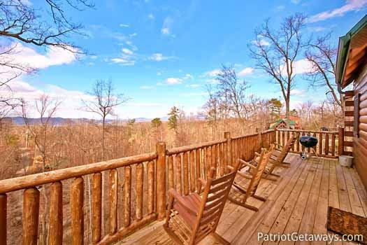 Main level back deck with rockers at Tree Top Lodge, a 3 bedroom cabin rental located in Gatlinburg