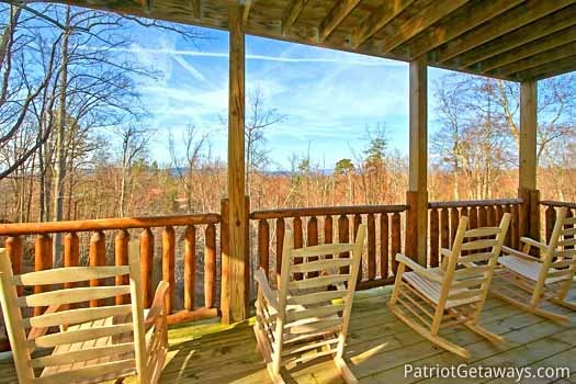 Second floor deck with rockers at Tree Top Lodge, a 3 bedroom cabin rental located in Gatlinburg