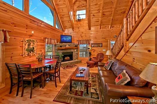 View of living room with fireplace at Tree Top Lodge, a 3 bedroom cabin rental located in Gatlinburg