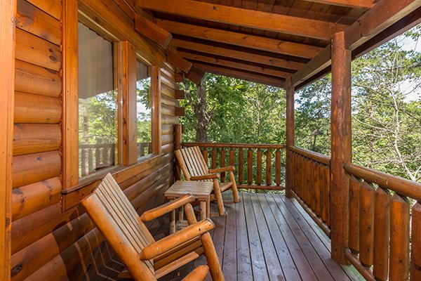 log furniture on a covered deck at animal kingdom a 4 bedroom cabin rental located in gatlinburg