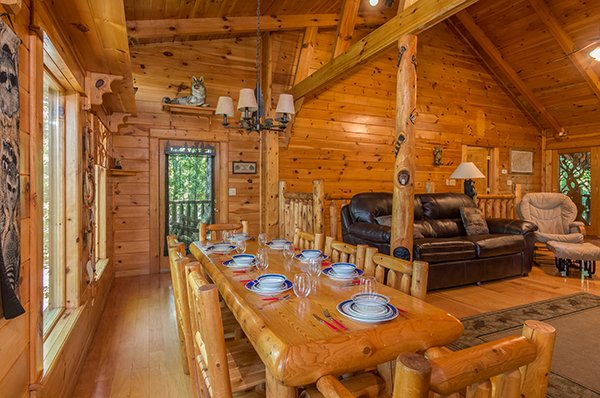 custom log dining table with seating for eight at animal kingdom a 4 bedroom cabin rental located in gatlinburg
