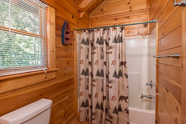 bathroom with a tub and shower at animal kingdom a 4 bedroom cabin rental located in gatlinburg