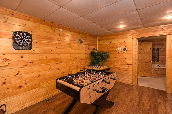 foosball table in the game room at animal kingdom a 4 bedroom cabin rental located in gatlinburg