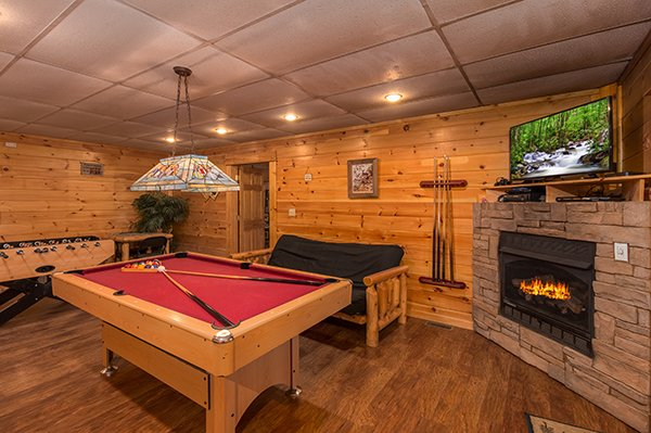 game room with foosball pool table and futon at animal kingdom a 4 bedroom cabin rental located in gatlinburg