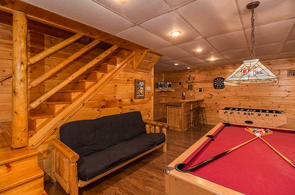 game room with futon pool table foosball table and bar at animal kingdom a 4 bedroom cabin rental located in gatlinburg