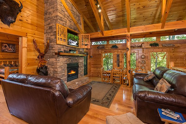 stacked stone fireplace in the living room at animal kingdom a 4 bedroom cabin rental located in gatlinburg
