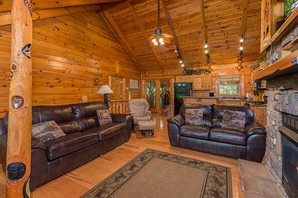 leather couch and loveseat in the living room at animal kingdom a 4 bedroom cabin rental located in gatlinburg