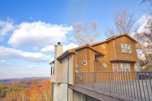 front exterior view with parking at smoky mountain high a 6 bedroom cabin rental located in gatlinburg