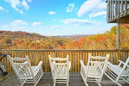 main level deck with rockers at smoky mountain high a 6 bedroom cabin rental located in gatlinburg
