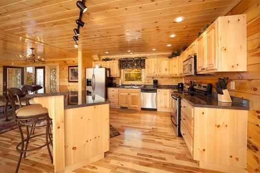 kitchen with island and stools at big bear cove a 3 bedroom cabin rental located in gatlinburg