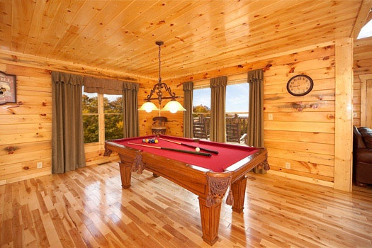 red felted pool table off living room at big bear cove a 3 bedroom cabin rental located in gatlinburg