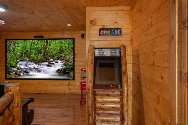Arcade game in the theater room at Four Seasons Palace, a 5-bedroom cabin rental located in Pigeon Forge