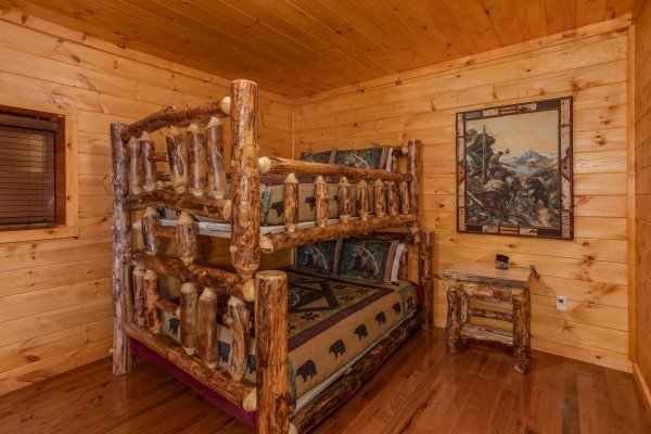 Log bunk bed at Four Seasons Palace, a 5-bedroom cabin rental located in Pigeon Forge