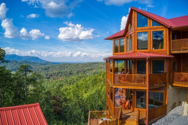 Cabin sitting in front of the mountains at Four Seasons Palace, a 5-bedroom cabin rental located in Pigeon Forge