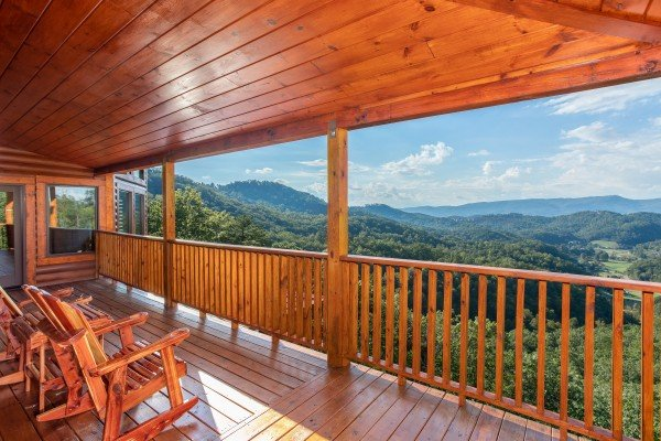 Rocking chairs on the deck overlooking the mountains at Four Seasons Palace, a 5-bedroom cabin rental located in Pigeon Forge
