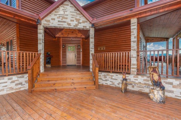 Entry porch at Four Seasons Palace, a 5-bedroom cabin rental located in Pigeon Forge