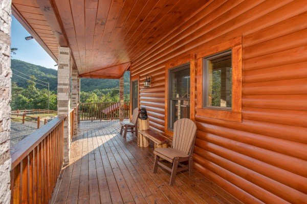 Porch with two chairs and a bench at Four Seasons Palace, a 5-bedroom cabin rental located in Pigeon Forge