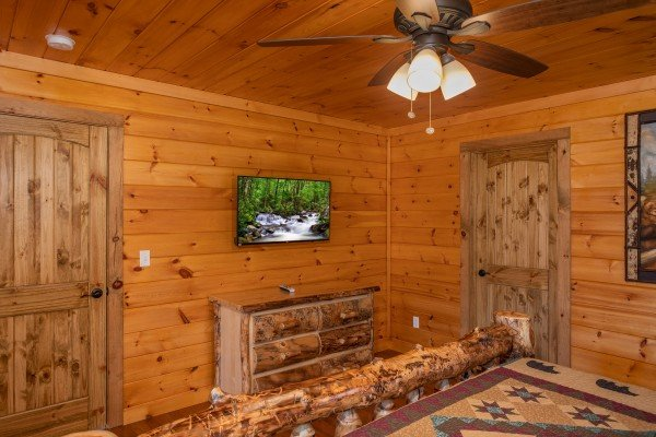 Bedroom with a tv and dresser at Four Seasons Palace, a 5-bedroom cabin rental located in Pigeon Forge