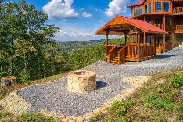 Fire pit in the picnic area at Four Seasons Palace, a 5-bedroom cabin rental located in Pigeon Forge