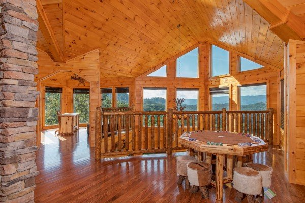 Game table in the loft at Four Seasons Palace, a 5-bedroom cabin rental located in Pigeon Forge