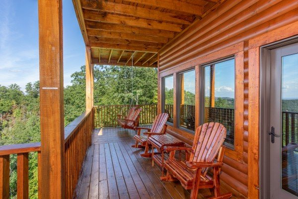 Gliding chairs on the porch at Four Seasons Palace, a 5-bedroom cabin rental located in Pigeon Forge