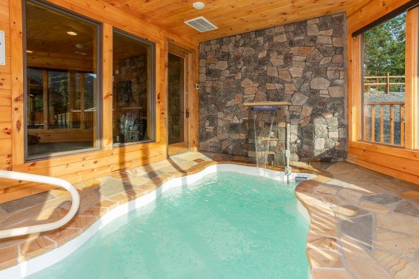 Water feature at the indoor pool at Four Seasons Palace, a 5-bedroom cabin rental located in Pigeon Forge