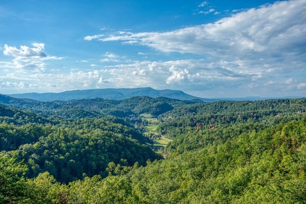 Views of the mountains surrounding a valley at Four Seasons Palace, a 5-bedroom cabin rental located in Pigeon Forge