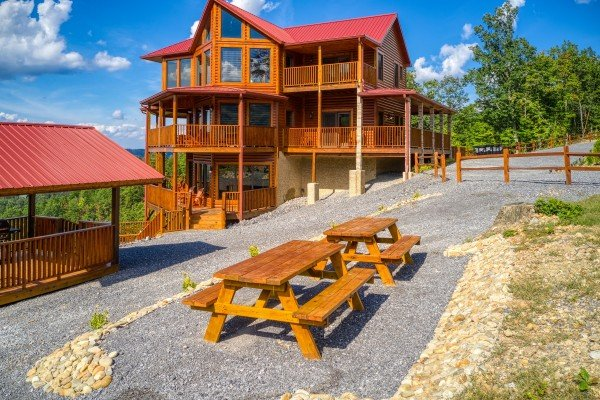 Two picnic tables outside at Four Seasons Palace, a 5-bedroom cabin rental located in Pigeon Forge