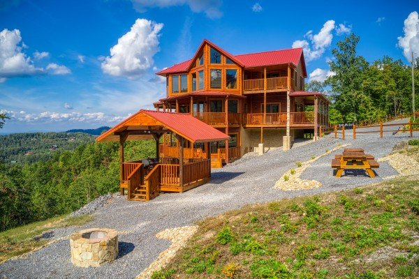 Picnic area and fire pit at Four Seasons Palace, a 5-bedroom cabin rental located in Pigeon Forge