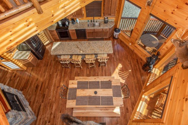 Looking down into the dining space for 12 people at Four Seasons Palace, a 5-bedroom cabin rental located in Pigeon Forge