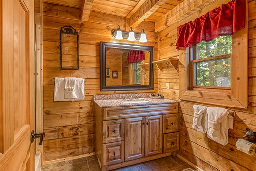 Bathroom vanity at Cupid's Crossing, a 1-bedroom cabin rental located in Pigeon Forge