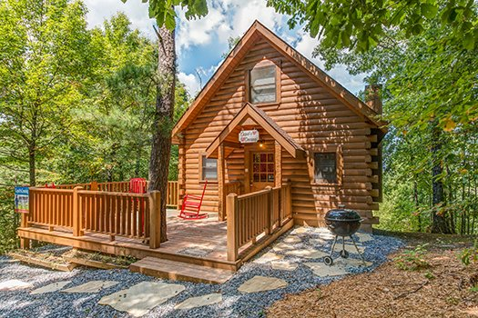 Front entrance with deck and flagstone at Cupid's Crossing, a 1-bedroom cabin rental located in Pigeon Forge