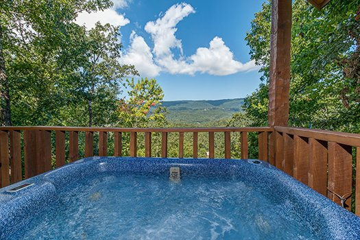 View of the mountains from the hot tub at Cupid's Crossing, a 1-bedroom cabin rental located in Pigeon Forge